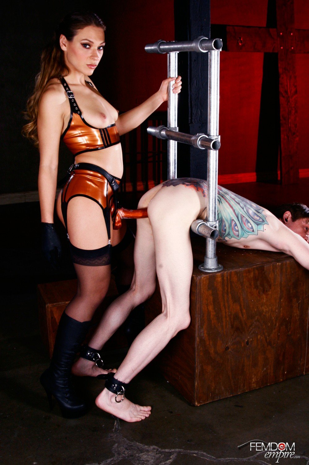image Strap on mistress pegging her slave